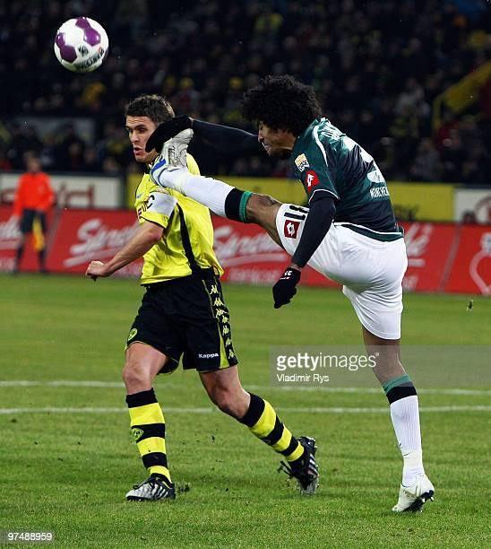 Dante of Moenchengladbach kicks the ball away of Sebastian Kehl of Dortmund during the Bundesliga match between Borussia Dortmund and Borussia...