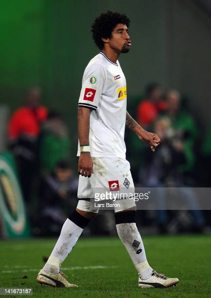 Dante of Moenchengladbach looks dejected after missing a penalty during the DFB Cup semi final match between Borussia Moenchengladbach and FC Bayern...