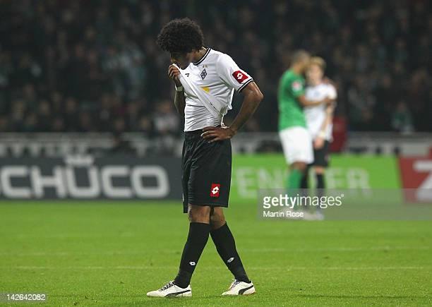Dante of Moenchengladbach looks dejected after the Bundesliga match between SV Werder Bremen and Borussia Moenchengladbach at Weser Stadium on April...