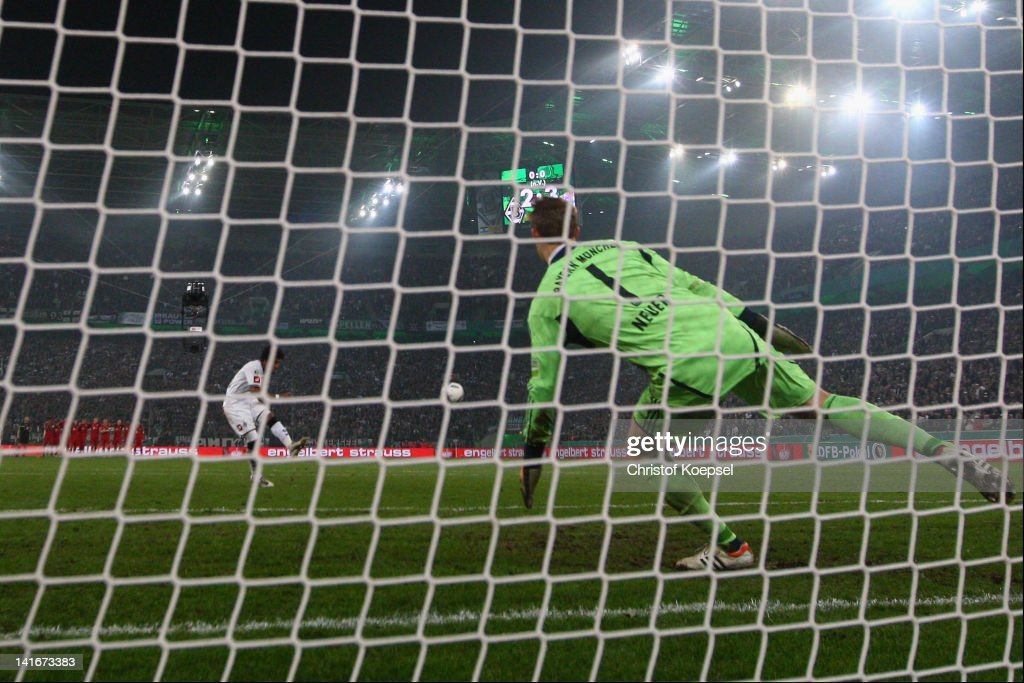 Dante of Moenchengladbach misses a penalty against Manuel Neuer (R) of Bayern during the penalty shoot-out during the DFB Cup semi final match between Borussia Moenchengladbach and FC Bayern Muenchen at Borussia Park Stadium on March 21, 2012 in Moenchengladbach, Germany. Bayern won 4-2 against Moenchengladbach after pelanty-shoot out.