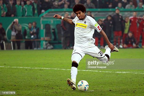 Dante of Moenchengladbach misses a penalty durign the penalty shootout during the DFB Cup semi final match between Borussia Moenchengladbach and FC...