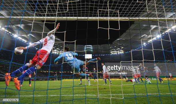 Dante of Muenchen celebrates scores the second goal during the DFB Cup quarter final match between Hamburger SV and Bayern Muenchen at Imtech Arena...