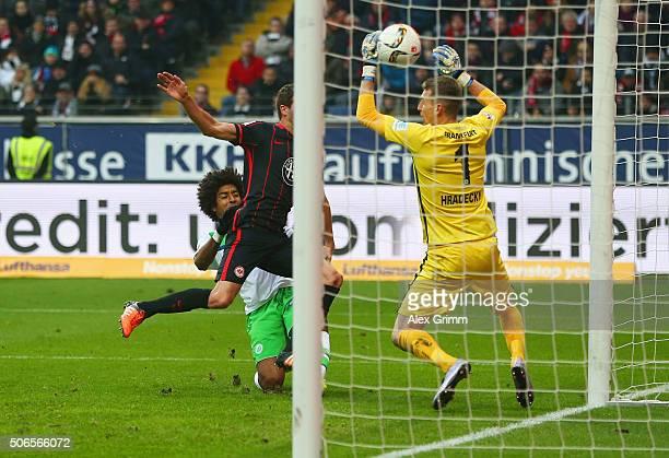 Dante of VfL Wolfsburg beats David Abraham of Eintracht Frankfurt to score their first goal past goalkeeper Lukas Hradecky of Eintracht Frankfurt...