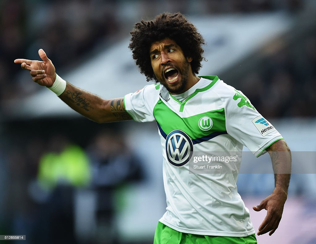 Dante of Wolfsburg reacts during the Bundesliga match between VfL Wolfsburg and FC Bayern Muenchen at Volkswagen Arena on February 27, 2016 in Wolfsburg, Germany.