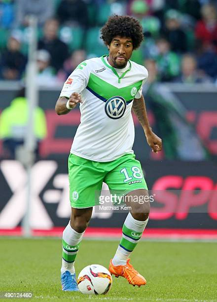 Dante of Wolfsburg runs with the ball during the Bundesliga match between VFL Wolfsburg and Hannover 96 at Volkswagen Arena on September 26 2015 in...