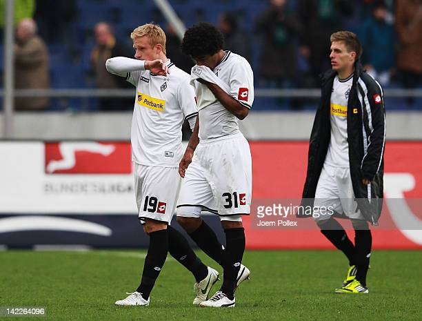 Dante Patrick Herrmann and Mike Hanke of Moenchengladbach are seen after during the Bundesliga match between Hanover 96 and Borussia Moenchengladbach...