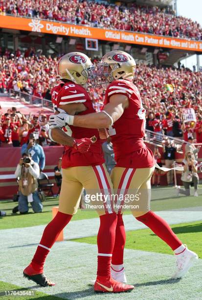 Dante Pettis and Kyle Juszczyk of the San Francisco 49ers celebrates after Pettis caught a touchdown pass late in the fourth quarter against the...