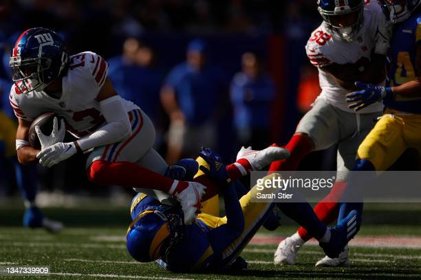 Dante Pettis of the New York Giants is tackled by Robert Rochell of the Los Angeles Rams during the second half at MetLife Stadium on October 17,...