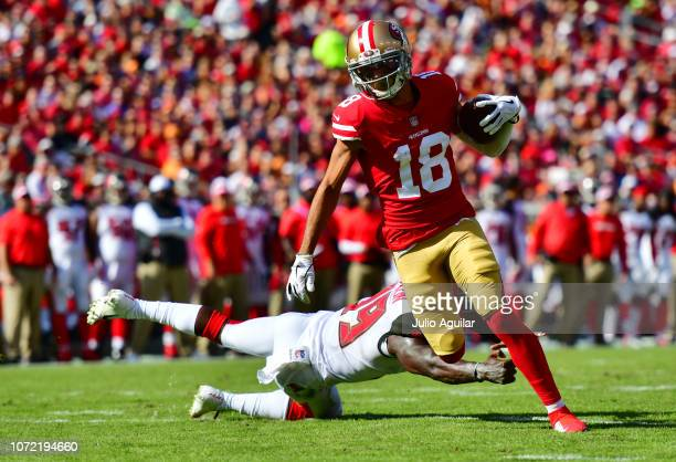 Dante Pettis of the San Francisco 49ers catches a 13yard pass for a touchdown in the second quarter against the Tampa Bay Buccaneers at Raymond James...
