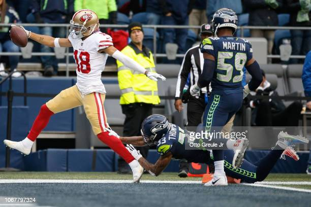 Dante Pettis of the San Francisco 49ers catches the ball for a touchdown in the third quarter against the Seattle Seahawks at CenturyLink Field on...