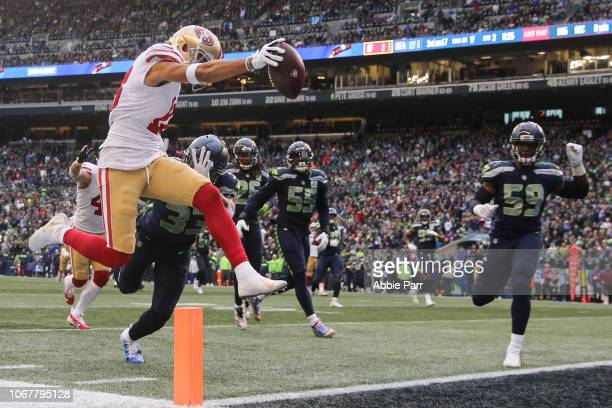 Dante Pettis of the San Francisco 49ers catches the ball over Tedric Thompson of the Seattle Seahawks for a touchdown in the third quarter at...