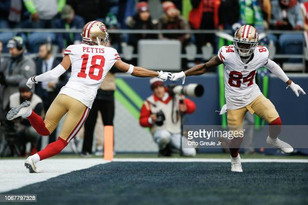 Dante Pettis of the San Francisco 49ers celebrates his touchdown with teammate Kendrick Bourne in the third quarter against the Seattle Seahawks at...