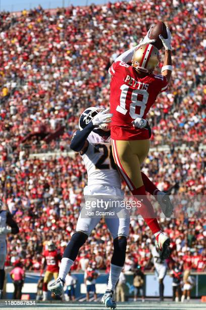 Dante Pettis of the San Francisco 49ers makes a catch in the endzone but is pushed out by Troy Hill of the Los Angeles Rams in the third quarter at...