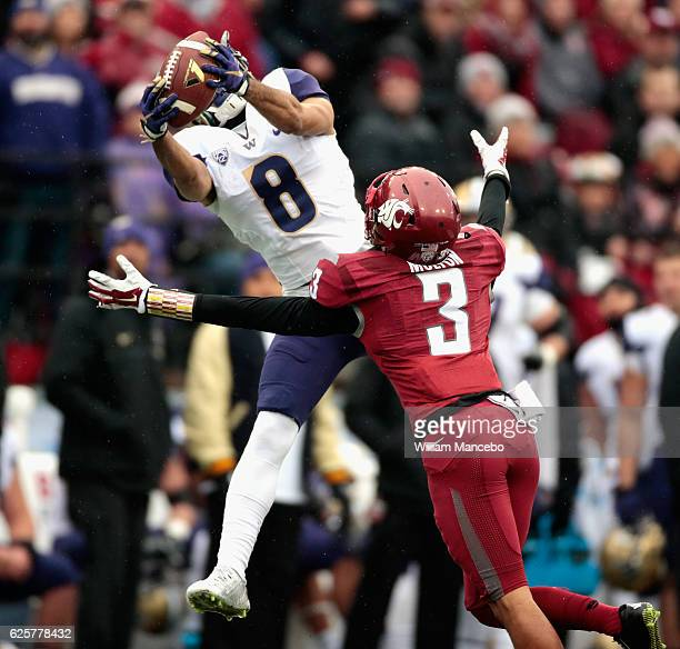Dante Pettis of the Washington Huskies catches a pass against Darrien Molton of the Washington State Cougars in the first half of the 109th Apple Cup...