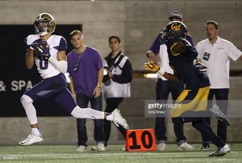 Dante Pettis #8 of the Washington Huskies catches the ball and then beats Chibuzo Nwokocha #16 of the California Golden Bears in for a touchdown at California Memorial Stadium on November 5, 2016 in Berkeley, California.