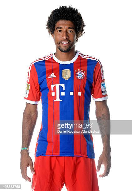 Dante poses during the FC Bayern Muenchen Team Presentation for DFL on August 9 2014 in Munich Germany
