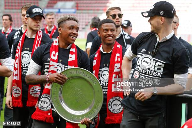 Dante Rigo of PSV Steven Bergwijn of PSV Kenneth Paal of PSV Marco van Ginkel of PSV Celebrate the championship during the PSV champions parade at...