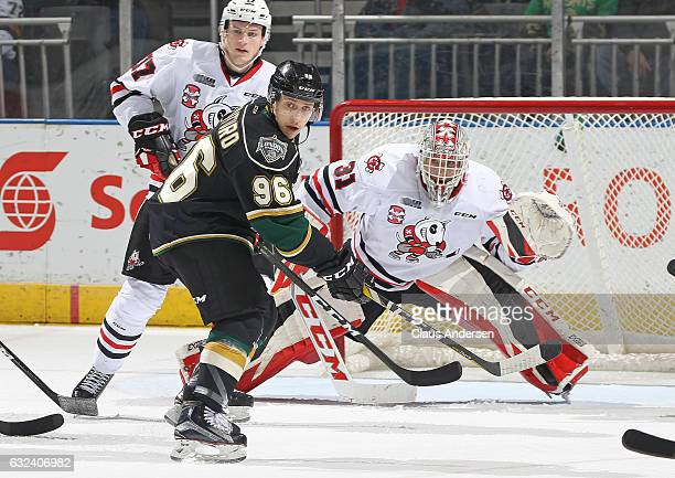 Dante Salituro of the London Knights looks for a shot to tip at Colton Incze of the Niagara IceDogs during an OHL game at Budweiser Gardens on...