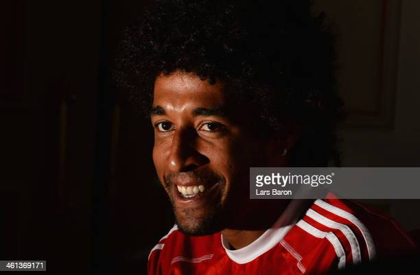 Dante smiles during a press conference at day 4 of the Bayern Muenchen training camp at ASPIRE Academy for Sports Excellence on January 8, 2014 in...