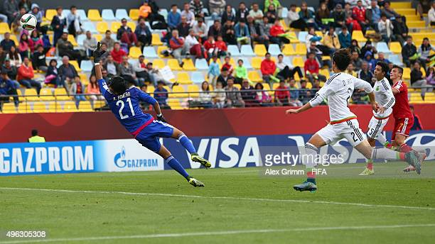 Dante Vanzeir of Belgium scores his team's second goal against goalkeeper Abraham Romero of Mexico during the FIFA U17 World Cup Chile 2015 Third...