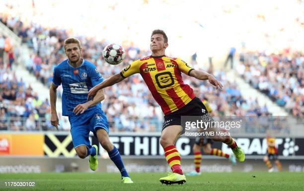 Dante Vanzeir of Kv Mechelen battles for the ball with Igor Plastun of Kaa Gent during the Jupiler Pro League match between KAA Gent and KV Mechelen...
