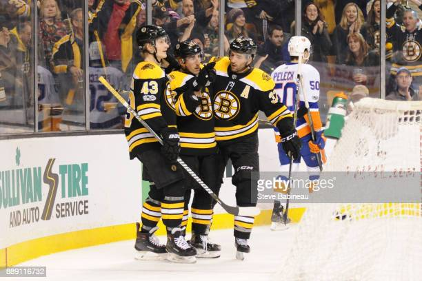 Danton Heinen Brad Marchand Patrice Bergeron of the Boston Bruins celebrate a second period goal against the New York Islanders at the TD Garden on...