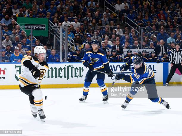 Danton Heinen of the Boston Bruins blocks a shot by Ivan Barbashev of the St Louis Blues in Game Three of the Stanley Cup Final during the 2019 NHL...