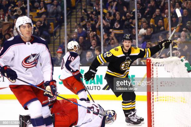 Danton Heinen of the Boston Bruins celebrates after scoring against the Columbus Blue Jackets during the third period at TD Garden on December 18...