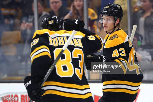 Danton Heinen of the Boston Bruins celebrates with Karson Kuhlman after scoring a goal against the Tampa Bay Lightning during the first period at TD...