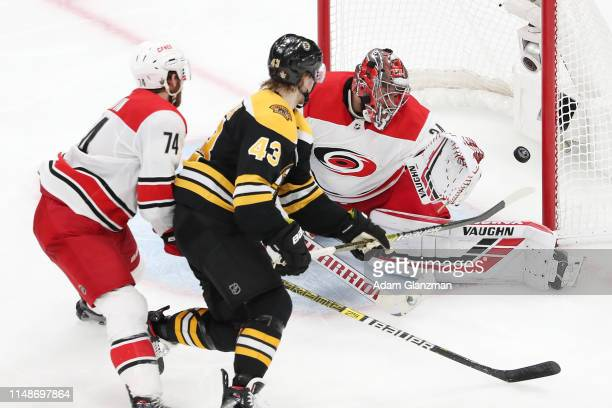 Danton Heinen of the Boston Bruins scores a third period goal against Petr Mrazek of the Carolina Hurricanes in Game Two of the Eastern Conference...
