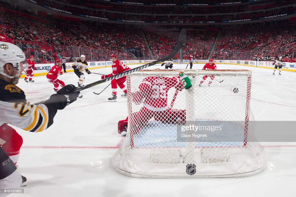 Danton Heinen #43 of the Boston Bruins scores a third period goal on Jimmy Howard #35 of the Detroit Red Wings during an NHL game at Little Caesars Arena on February 6, 2018 in Detroit, Michigan. The Bruins defeated the Wings 3-2.