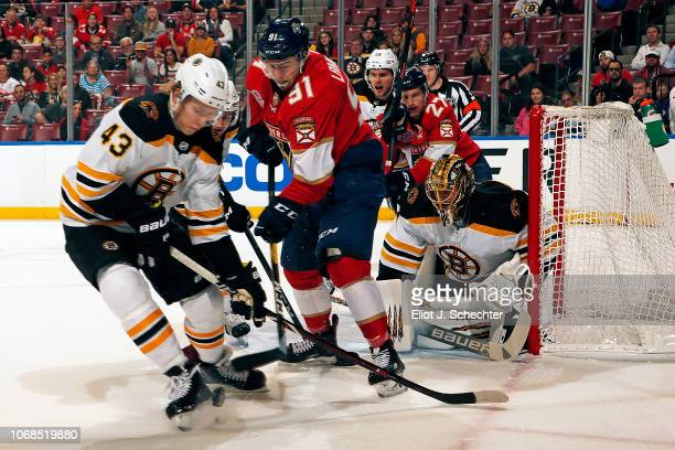 Danton Heinen of the Boston Bruins tangles with Juho Lammikko of the Panthers at the BB&T Center on December 4, 2018 in Sunrise, Florida.