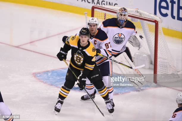 Danton Heinen of the Boston Bruins watches the play against Connor McDavid and Cam Talbot of the Edmonton Oilers at the TD Garden on November 26 2017...