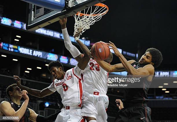 Danuel House and Danrad Knowles of the Houston Cougars battle for a rebound with Josh Huestis of the Stanford Cardinal during the second half at...