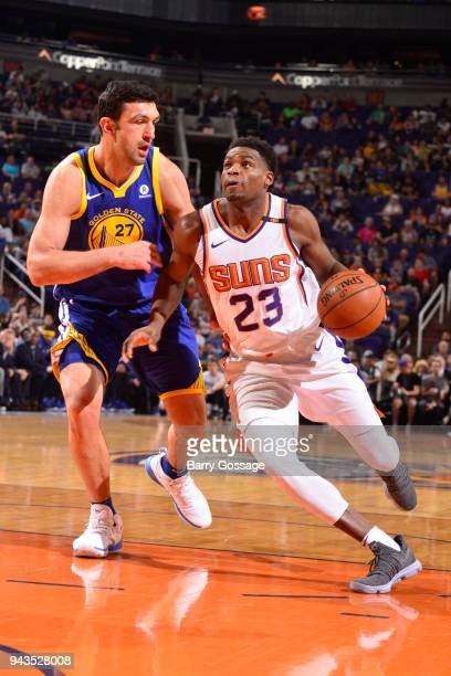 Danuel House Jr #23 of the Phoenix Suns looks to shoot the ball during the game against Zaza Pachulia of the Golden State Warriors on April 8 2018 at...