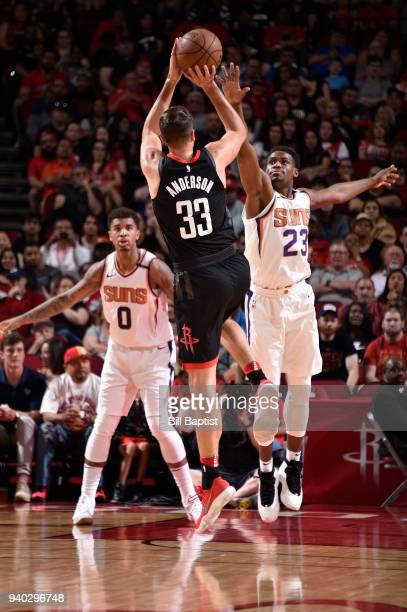 Danuel House Jr #23 of the Phoenix Suns plays defense against Ryan Anderson of the Houston Rockets on March 30 2018 at the Toyota Center in Houston...