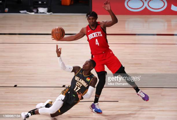 Danuel House Jr. #4 of the Houston Rockets and Dennis Schroder of the Oklahoma City Thunder battle for the ball during the third quarter in Game Six...