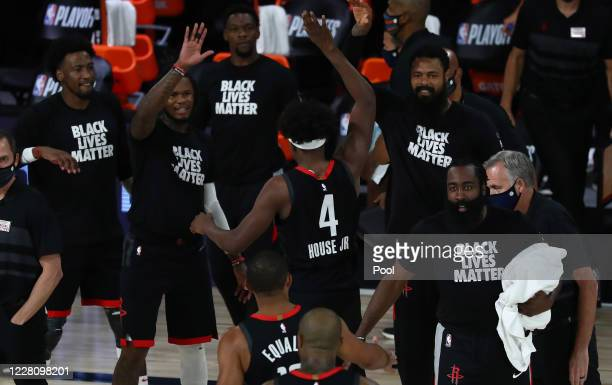 Danuel House Jr. #4 of the Houston Rockets celebrates with his teammates after a play against the Oklahoma City Thunder during the first half in game...