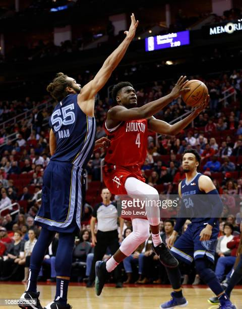 Danuel House Jr #4 of the Houston Rockets drives past Joakim Noah of the Memphis Grizzlies for a layup during the second quarter at Toyota Center on...