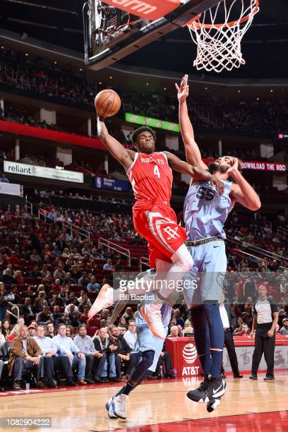 Danuel House Jr #4 of the Houston Rockets drives to the basket during the game against Joakim Noah of the Memphis Grizzlies on January 14 2019 at the...