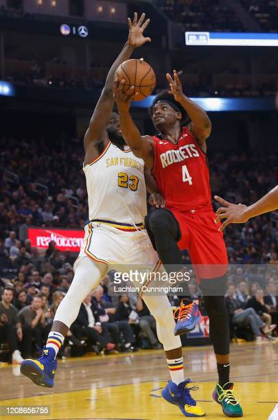 Danuel House Jr #4 of the Houston Rockets goes to the basket against Draymond Green of the Golden State Warriors in the first half at Chase Center on...