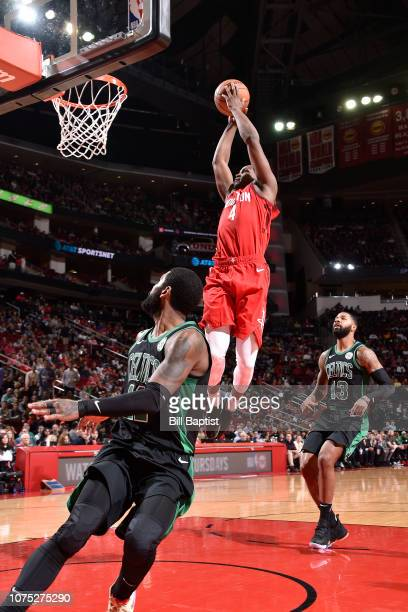 Danuel House Jr #4 of the Houston Rockets goes up for a dunk against the Boston Celtics on December 27 2018 at the Toyota Center in Houston Texas...