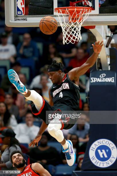 Danuel House Jr #4 of the Houston Rockets is fouled by Kenrich Williams of the New Orleans Pelicans during a NBA game at the Smoothie King Center on...