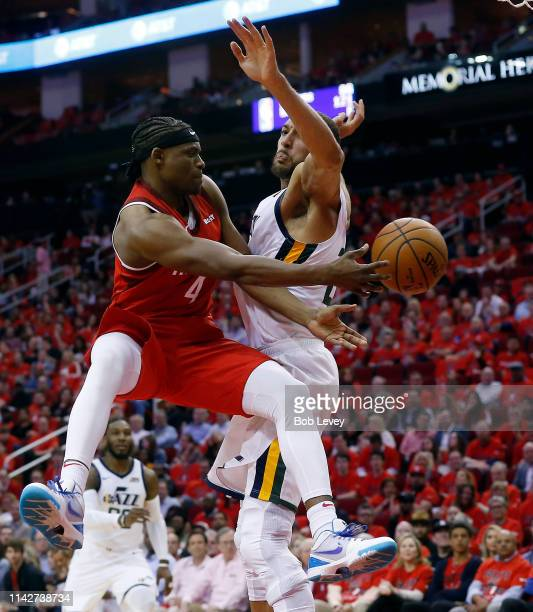 Danuel House Jr #4 of the Houston Rockets passes around Rudy Gobert of the Utah Jazz during the fourth quarter during Game One of the first round of...