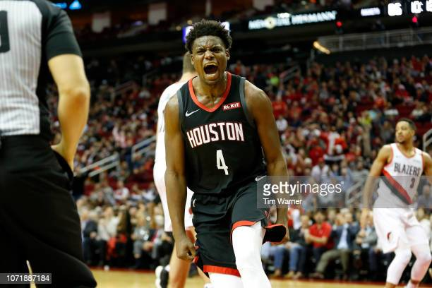 Danuel House Jr #4 of the Houston Rockets reacts after dunking the ball in the second half against the Portland Trail Blazers at Toyota Center on...