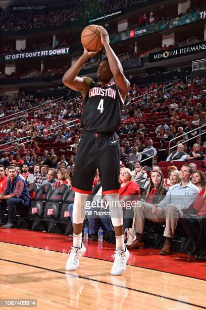 Danuel House Jr #4 of the Houston Rockets shoots the ball against the Dallas Mavericks on November 28 2018 at the Toyota Center in Houston Texas NOTE...