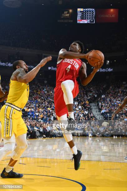 Danuel House Jr #4 of the Houston Rockets shoots the ball against the Golden State Warriors on January 3 2019 at ORACLE Arena in Oakland California...
