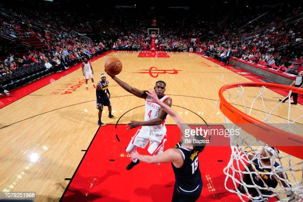 Danuel House Jr #4 of the Houston Rockets shoots the ball against the Denver Nuggets on January 7 2019 at the Toyota Center in Houston Texas NOTE TO...