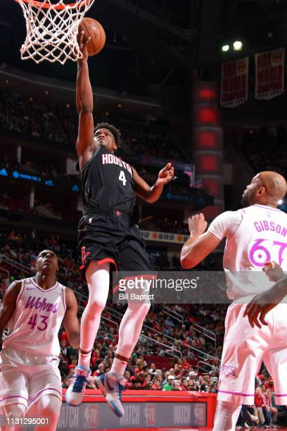 Danuel House Jr #4 of the Houston Rockets shoots the ball against the Minnesota Timberwolves on March 17 2019 at the Toyota Center in Houston Texas...