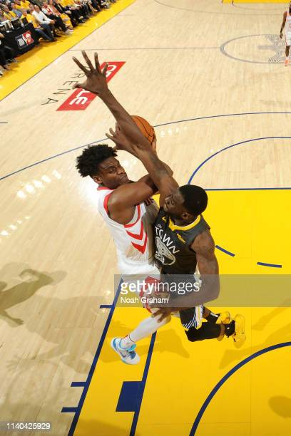Danuel House Jr #4 of the Houston Rockets shoots the ball around Draymond Green of the Golden State Warriors during Game Two of the Western...
